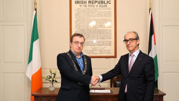 Micheal Mac Donncha and Ahmad Abdelrazek launch the book of condolence at Mansion House