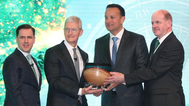 Apple CEO Tim Cook is presented with the inaugural IDA Ireland Special Recognition Award by Taoiseach Leo Varadkar (Niall Carson/PA)