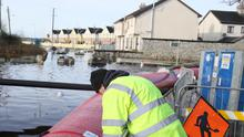 Members of Westmeath County Council continue their efforts to keep floodwaters at bay in Athlone (Brian Lawless/PA)
