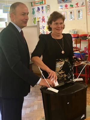 Micheal Martin and his wife Mary voting in Cork (Handout/PA)