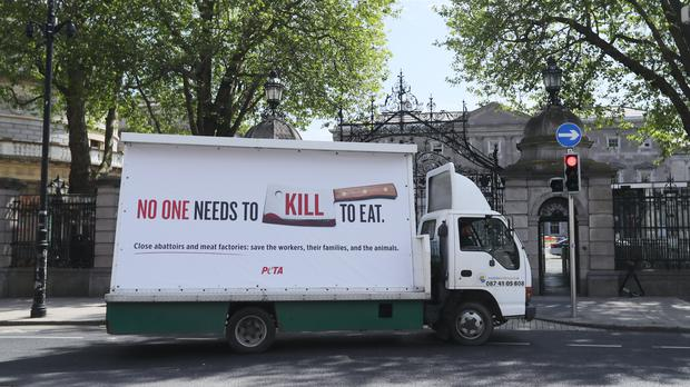 A Peta billboard, calling for the closure of abattoirs and meat factories (Niall Carson/PA)