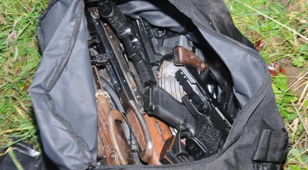 Gardai discovered 10 firearms and a quantity of ammunition during searches in north Dublin (Garda/PA)