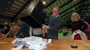 Ballot papers are counted at the RDS in Dublin (Niall Carson/PA)
