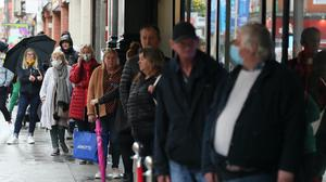 Customers in line outside Arnotts (Brian Lawless/PA)