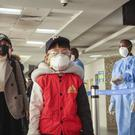 Passengers arriving from a flight from Changsha in China are screened for the new type of coronavirus (Patrick Ngugi/AP)