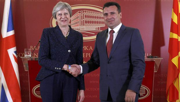 Theresa May shakes hands with Macedonian counterpart Zoran Zaev (Boris Grdanoski/AP)