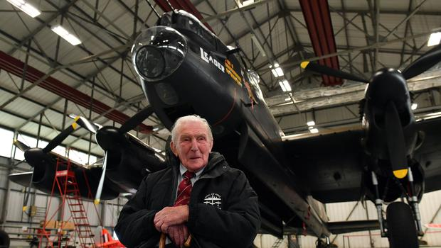 Johnny Johnson, the last survivor of the original Dambusters of 617 Squadron, sits beneath an Avro Lancaster bomber at RAF Coningsby, Lincolnshire (Joe Giddens/PA)