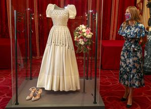 Princess Beatrice with her wedding dress as it went on display at Windsor Castle. Beatrice married Edoardo Mapelli Mozzi in July (Steve Parsons/PA)