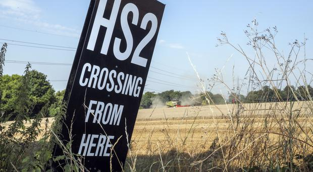 An HS2 sign near South Heath in Buckinghamshire where the high speed line will pass through the Chiltern Hills (Steve Parsons/PA)