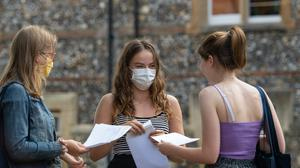 Benita Stipp (centre) and Mimi Ferguson (left) react as students at Norwich School, Norwich, receive their A-Level results (Joe Giddens/PA)