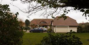 Police at the house where Valerie Graves was found dead (Chris Ison/PA)