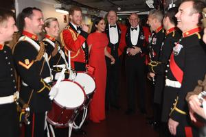 The Duke and Duchess of Sussex alongside the Massed Bands of Her Majesty's Royal Marines at The Mountbatten Festival of Music at the Royal Albert Hall in early March (Eddie Mulholland/Daily Telegraph/PA)