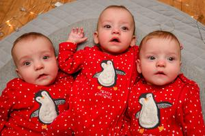Triplets Rafferty, Willoughby and Emmeline love twinkly lights, mother Sarah Davis said (Ben Birchall/PA)