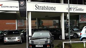 Stratstone Cadillac dealership, owned by Pendragon, near Newcastle. Pendragon has said it will shut 15 dealerships and cut 1,800 jobs (Peter Byrne/PA)