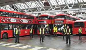 Staff observed the silence at Camberwell bus depot in London (Dominic Lipinski/PA)