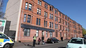 Police outside a block of flats on Dumbarton Road, Clydebank, where the incident occurred (Andrew Milligan/PA)
