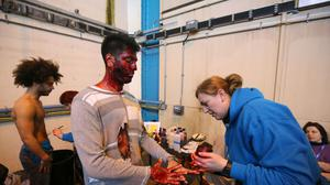 Actors prepare in make-up for the exercise