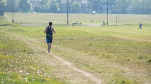 A runner on Blackheath, in south London, which is the start of the course for the London Marathon (Dominic Lipinski/PA)