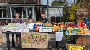 The Barry family and a free vegetable stall in Breightmet, Bolton (Angela Barry/PA)