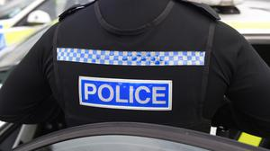 An off-duty police officer has been arrested on suspicion of the murder of his wife.