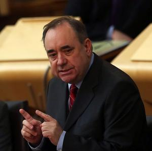 Scottish First Minister Alex Salmond has hit out at Chancellor George Osborne for his comments about the pound under independence