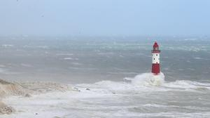 Waves crash at Beachy Head Lighthouse, near Eastbourne, East Sussex, as winds of up to 70mph are expected along the coast during the next 36 hours along with up to 90mm of rain as Storm Francis hit the UK.