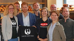Prince Harry meets people involved in the One of Us campaign in Copenhagen (Jonathan Brady/PA)