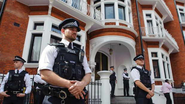 Police officers outside the Embassy of Ecuador, in Knightsbridge, central London, where Wikileaks founder Julian Assange is claiming asylum