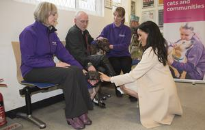 The duchess met Wully Struthers and his staffies Azzy and Gallis during her trip to the animal welfare charity (Eddie Mulholland/Daily Telegraph)