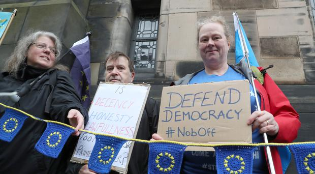Protesters outside the Court of Session in Edinburgh (Andrew Milligan/PA)