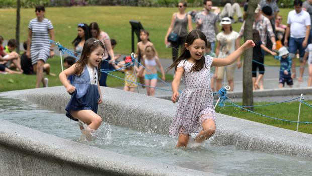 Children cool off in the Diana Memorial Fountain in Hyde Park, London (John Stillwell/PA)