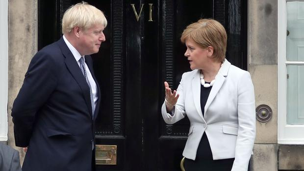 Scotland's First Minister Nicola Sturgeon said that Nigel Farage is now pulling Prime Minister Boris Johnson's strings (Jane Barlow/PA)