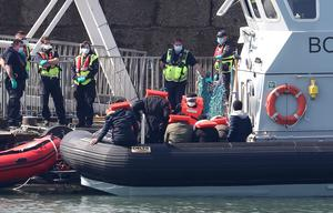 Border Force officers preparing to bring to shore men thought to be migrants in Dover (Gareth Fuller/PA)