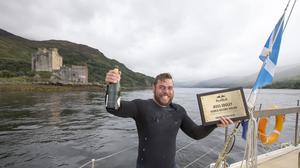 Ross Edgley celebrates on board a boat off Kyle of Lochalsh on the west coast of Scotland (Red Bull Media House)