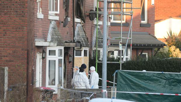 Forensic officers at the scene of the fire on Jackson Street in Worsley, Greater Manchester (Peter Byrne/PA)