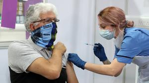 John Loch, 69, receives his Covid-19 vaccination from Nicole Clark at the NHS Louisa Jordan Hospital in Glasgow (Andrew Milligan/PA)