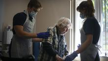 Rehab support workers give physiotherapy treatment to patient Michael Kidd (Victoria Jones/PA)