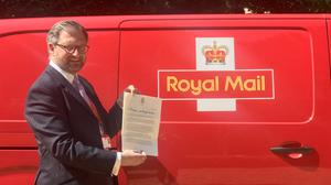 Royal Mail director of public affairs and policy David Gold holds the letter (Clarence House/PA)