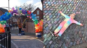 Kiera, 12 (left) and Kadi-Lei, seven, have created a giant rainbow tribute to the NHS on their street in Manchester (Emma Mcgowan)