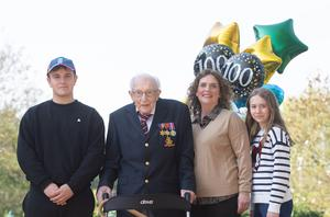 99-year-old war veteran Captain Tom Moore, with (left to right) grandson Benji, daughter Hannah Ingram-Moore and granddaughter Georgia (Joe Giddens/PA)