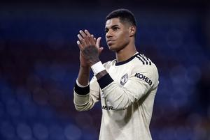 Footballer Marcus Rashford called for the Government to extend its free school meal voucher scheme through the summer (PA)