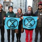 From left to right: David Lambert (left), 60, a historian from Gloucestershire, Phoebe Valentine, 23, a maths student from Brighton, Claudia Fisher, 57, a business woman from Brighton, Senan Clifford, 59, a former teacher from Gloucestershire, and Ben Bont (right), 42, a tree surgeon from West Wales, arrive at the City of London Magistrates' Court, after they were arrested on 10 October 2019, during a peaceful demonstration – in which they glued themselves to the concourse between the DLR station and City Airport in east London (Jonathan Brady/PA)