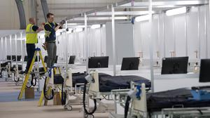 Work continues at the ExCel centre in London which is being made into a temporary hospital – the NHS Nightingale hospital, comprising of two wards, each of 2,000 people, to help tackle coronavirus (Stefan Rousseau/PA).