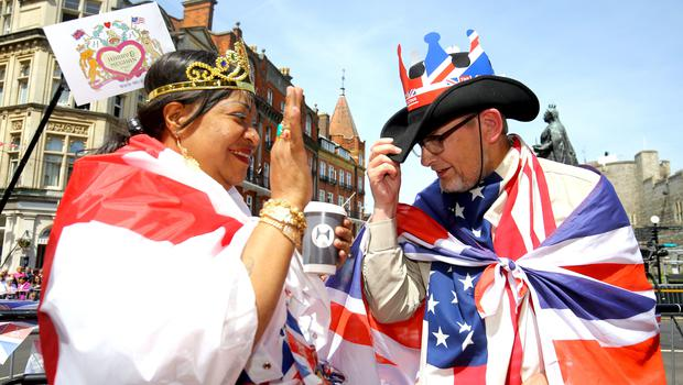 Pleased to meet you: Royal fans greet each other as they take their positions outside Windsor Castle (Gareth Fuller/PA)