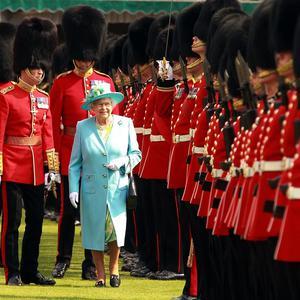 The Queen inspects The Queen's Company before presenting New Colours to Nijmegen Company in the gardens of Buckingham Palace