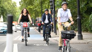 Mayor of London Sadiq Khan tries out a new Streetspace protected cycle lane in London (Stefan Rousseau/PA)