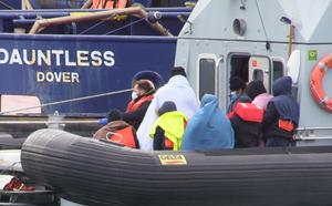 A group of people, thought to be migrants, waiting on a Border Force rib to come ashore at Dover (Michael Drummond/PA)
