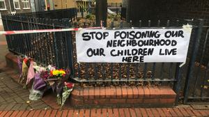 Floral tributes and a sign near the scene in Charlotte Despard Avenue, Battersea, south-west London (Tom Horton/PA)