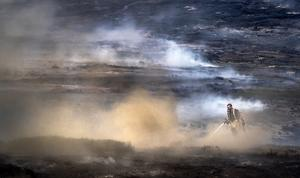Firefighters tackling the wildfire on Saddleworth Moor in 2018 (Danny Lawson/PA)