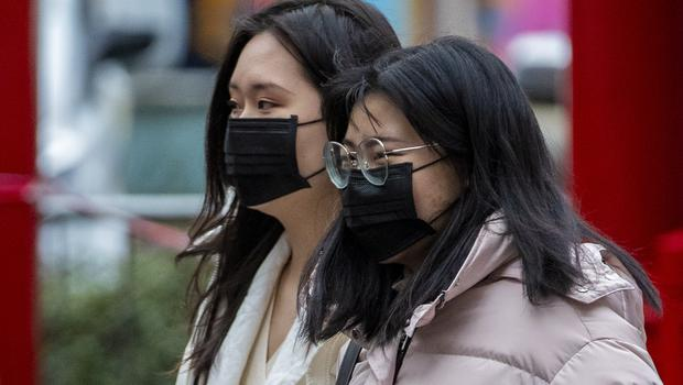 People have been wearing masks amid fears over the virus spreading (Peter Byrne/PA)